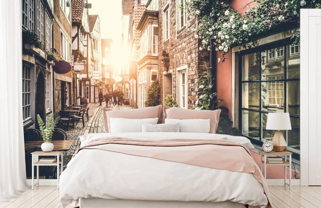 Städer tapet Solnedgång i en gammal gata 7