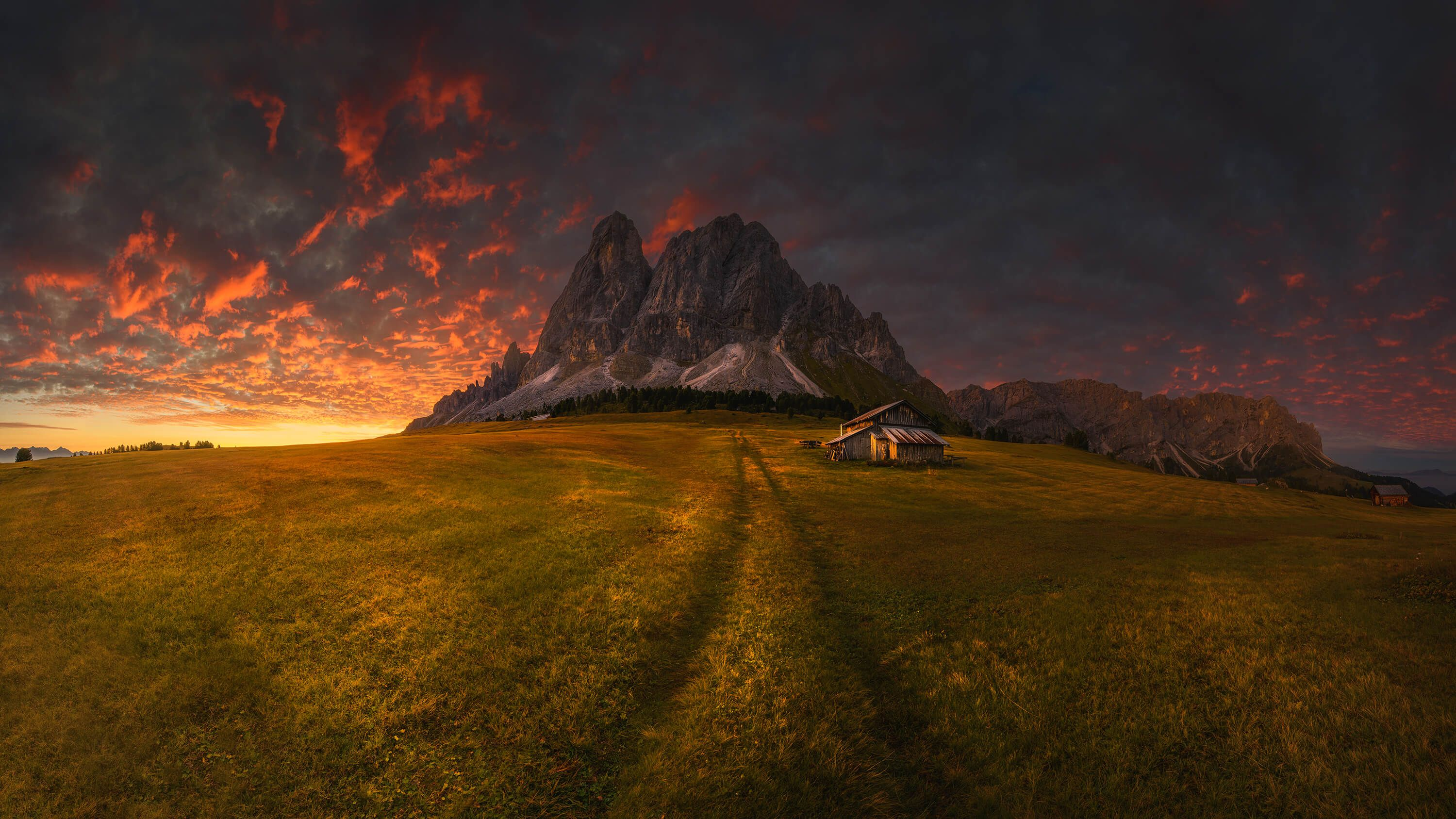 Sunset by a mountain